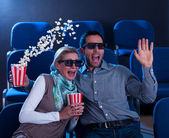 Couple reacting in shock to a 3D movie — Stock Photo