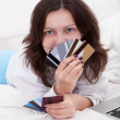 Woman with a fistful of credit cards — Stock Photo