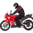 Biker rider his red motorcycle - Stock Photo