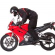 Biker standing up while riding his motorbike — Foto Stock