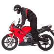 Biker standing up while riding his motorbike — Stock Photo