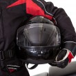 Man in protective gear with his motorbike — Stock Photo #18597117