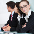 Beautiful young businesswoman in a meeting — Stock Photo #18597255