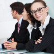 Beautiful young businesswoman in a meeting — Stock Photo