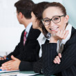 Beautiful young businesswoman in a meeting - Stock Photo