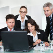 Smiling successful business team - Stock Photo
