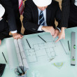 Architects discussing a blueprint — Stock Photo