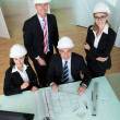 Architects discussing a blueprint — Stock Photo #18597525