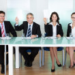 Group of judges holding up blank cards - Stock Photo