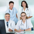 Medical team posing in an office — Stockfoto