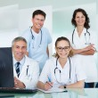 Medical team posing in an office — Stock Photo #18597617