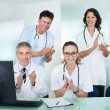 Royalty-Free Stock Photo: Happy medical team giving a thumbs up