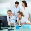 图库照片: Paramedical or technical staff in a lab