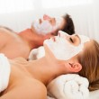 Man and woman in face masks — Stock Photo