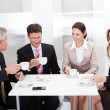 Business colleagues relaxing over coffee — Stock Photo #18598019