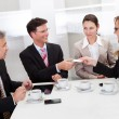 Businesspeople exchanging cards over coffee — Stock Photo #18598073