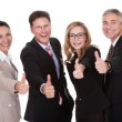 Stock Photo: Business executives giving a thumbs up