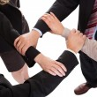 Businesspeople linking hands - teamwork — Stock Photo #18598251