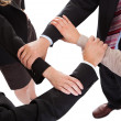 Businesspeople linking hands - teamwork — Stock Photo