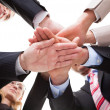 Businesspeople holding hands — Stockfoto