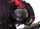 Adam onun motosiklet ile koruyucu giysiler içinde — Stok fotoğraf