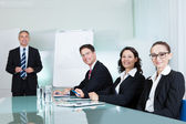 Business team holding a meeting — Stock Photo
