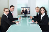 Businesspeople watching an online presentation — Stok fotoğraf