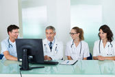 Doctors having a meeting — Stockfoto