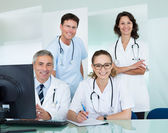 Medical team posing in an office — Stock Photo