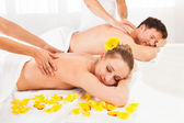 Attractive couple having a massage — Stok fotoğraf