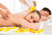 Attractive couple having a massage — Foto Stock