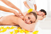 Attractive couple having a massage — Stock fotografie