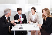 Business colleagues relaxing over coffee — Stock Photo