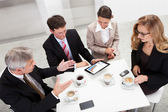 Business colleagues enjoying a coffee break — Stock Photo