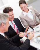 Business colleagues enjoying a coffee break — Stock Photo