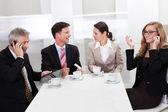 Business executives enjoying coffee — Stock Photo