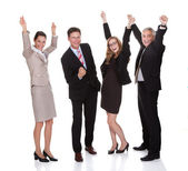 Four businesspeople celebrating — Stock Photo