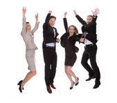 Cuatro socios saltando de alegría — Foto de Stock