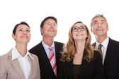 Four happy business partners looking up — Stock Photo