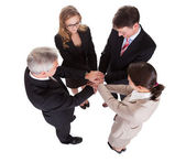 Businesspeople holding hands - teamwork — Stock Photo