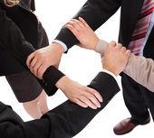 Businesspeople linking hands - teamwork — Stock Photo