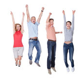 Happy couples jumping in the air rejoicing — Stockfoto