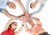 Four casual middle-aged friends holding hands — Stock Photo