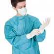 Surgeon putting on surgical gloves — Stock Photo