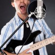 Foto Stock: Singer with guitar