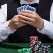 Stock Photo: Poker player on winning streak