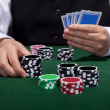 Stock Photo: Poker player about to place a bet