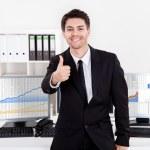 Confident smiling stock broker — Stock Photo