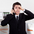 Worried stock broker on the phone — Stock Photo