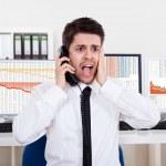 Worried stock broker on the phone — Stock Photo